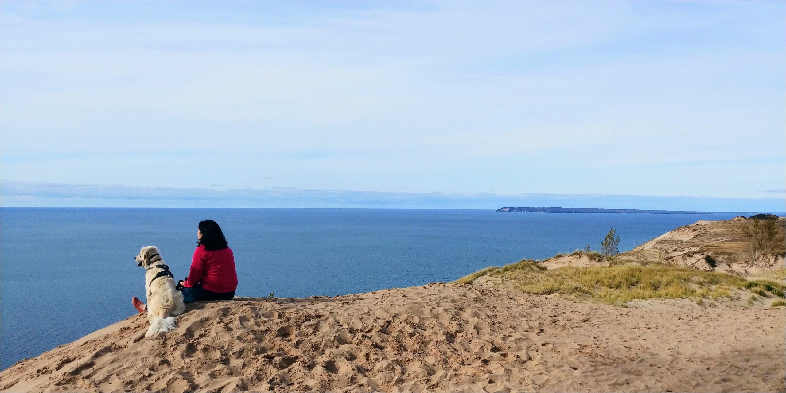 Woman and dog overlooking Lake Michigan at Sleeping Bear Dunes National Lakeshore